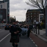 Lone-Piper-leads-procession.jpg