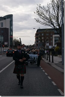 Lone Piper leads procession