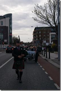 Lone Piper leads procession