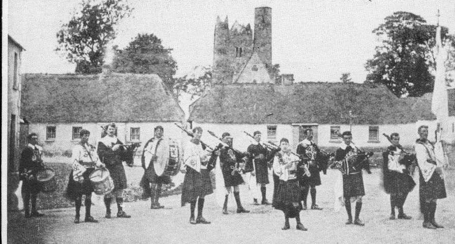 Thomas Ashe (third from left) in the Black Raven Pipe Band.