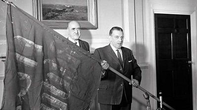 Sean Lemass with the original flag which flew over the GPO in 1916.