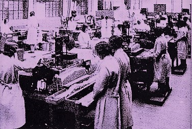 "Women at work on one of the ""intelligent"" packing machines."